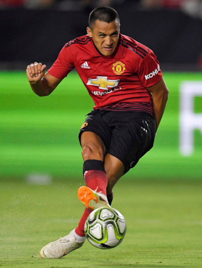 On target: Manchester United striker Alexis Sanchez scores during the first half of the International Champions Cup match against AC Milan