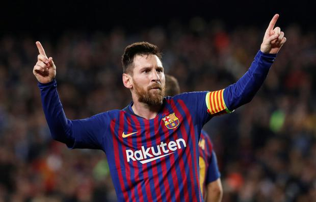 Barcelona's Lionel Messi celebrates after scoring his side's third goal during the Champions League semi-final win over Liverpool at the Nou Camp. Photo: Reuters