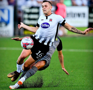 Physical: Dundalk's Dylan Connolly is fouled by AEK Larnaca's Hector Hevel during the UEFA Europa League second qualifying round first-leg match at Oriel Park