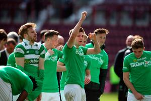 Celtic's Kieran Tierney (centre) and team-mates celebrate winning the league