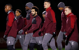 Liverpool players are pictured in training ahead of tonight's Champions League clash with Napoli at Anfield