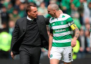 Celtic manager Brendan Rodgers and captain Scott Brown will pit their wits against Rangers again today. Pic: PA