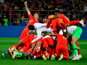 WORLD IN MOTION: Eric Dier is mobbed by his England team-mates after scoring the winning penalty in the World Cup last-16 shoot-out with Colombia at the Spartak Stadium, Moscow last night