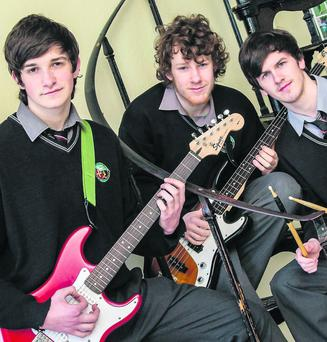 Gaelcholaiste Chiarrai students Séamus ó Cochúir, Cathal ó Síocháin and Séamus ó Beoláin on their way to the All-Ireland after winning the Munster Scleip competition