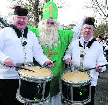 Mike Cahillane as St Patrick with Pat Pigott and Mike Dowd of the Killorglin Pipe Band participating in the St Patrick's Day Parade Killorglin on Sunday. Photo: Michelle Cooper Galvin.