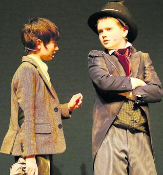 Matthew Dineen from Ballyheigue in the role of Oliver and Mairtin O Cathasaigh from Lispole in the role of the Artful Dodger (above and inset) in rehearsals for Tralee Musical Society's production of Oliver at Siamsa Tire.