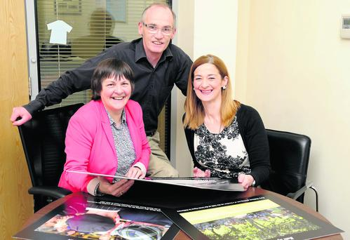 Michelle Cooper Galvin, photographer, Declan Malone, editor, The Kerryman, and Deirdre Walsh, Radio Kerry, browsing through some of Michelle's images for her photographic exhibition during the Women in Media Conference in Ballybunion on Satyrday 27th April. Photo by Michelle Cooper Galvin.