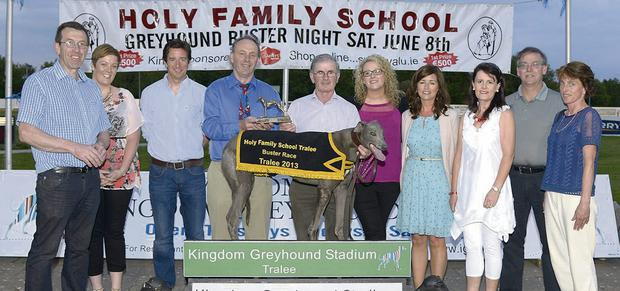 Principal of the Holy Family School Tralee Ed O'Brien, fourth from left, presents the winner's trophy to winning owner Peter Regan from Ardfert. Included, from left, are Declan Dowling, Claire Dempsey, Niall Morgan, Michelle O'Sullivan, Niamh Shanahan, Linda Hanafin, Jimmy Browne and Karon McLysaght. Photo: Denis Walsh