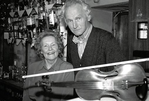 The late Brosna fiddle player and publican, Con Curtin pictured with his wife Ann in their pub. Photo: John Reidy