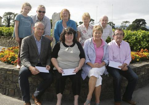 Vera O'Sullivan, of Glenbeigh Community Council, presenting awards to (front from left) Kieran O'Toole, Best Kept Private Residence; Catriona Murphy, Seaview Estate - Best Kept Estate; Brian Sugrue, Best Kept Business, with (at back, from left) Orla and Gerard Burke, Margaret Riordan, Joan Connors and Tony McSweeney in Glenbeigh.