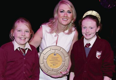 Scarlett O'Reilly and Isobel O'Donoghoe pick up the prize for Fossa NS.