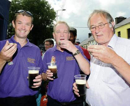 Darragh O'Driscoll, John Fleming and Con McCarthy enjoying oysters and Guinness at The Oratory, Cahersiveen