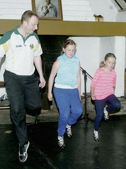 Johnny Cronin putting Sarah and Aoife Murphy through their paces at the Sean McCarthy Festival