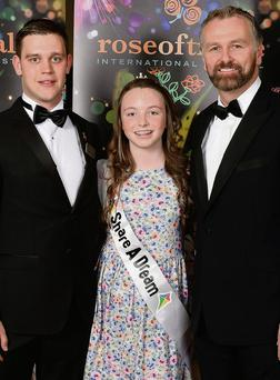 Colleen Whelan, from Graiguenamanagh, from the Share A Dream charity pictured with her escort Des O'Callaghan and TV presenter Daithi O Se at the Rose of Tralee Festival. Photo: Domnick Walsh/Eye Focus