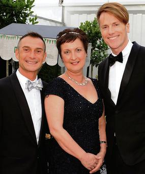 Jackie Crobe with fashion designer Don O'Neill, right, and Pascal Guillermie at the Kerrygold International Rose Ball at the Rose of Tralee Festival Dome on Friday night. Picture: Eye Focus