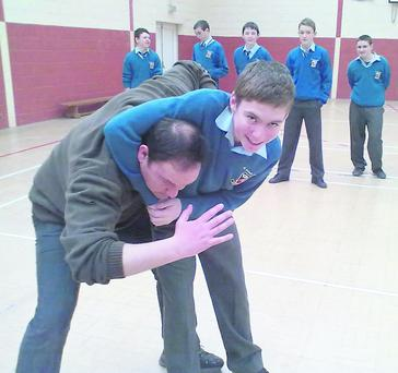 Student Thomas Doherty gets to grips with his teacher Mr Nelligan as part of the self-defence classes at St Michael's Listowel.