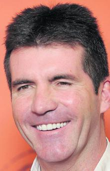 Simon Cowell showing the benefits of teeth whitening.