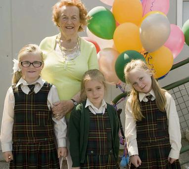 Máire Bean Uí Chonchúir founder of the Gaelscoil in Listowel is pictured with current students Alexa de Baróid, Dáibhín Léid, Isobel de Staic at an event to mark the 20th anniversary of the school. Photo: Ann McNamee