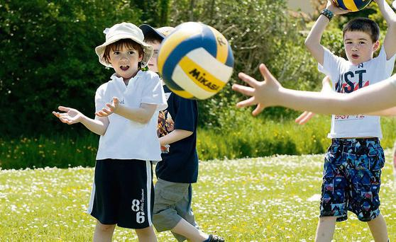 Eye on the ball! Pictured are Daniel Sheehy and James Crean from Blennerville National School taking part in the school's annual sports day. Photo: Pauline Dennigan
