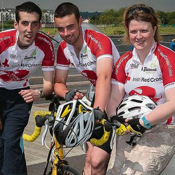 Jason Wallace, James McDonnell and Majella Forde of the Red Cross looking forward to doing the Heroes Cycle Challenge. Photo: Paul Tearle