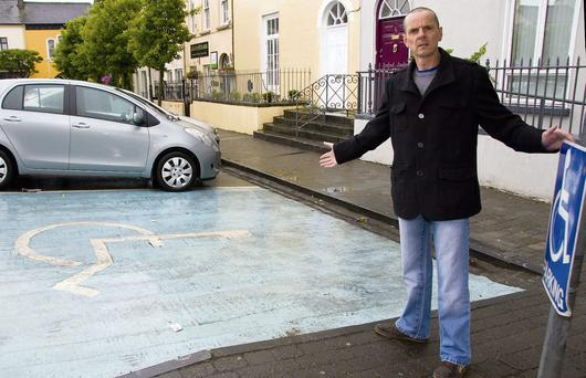 It's empty now, but disabled parking spaces like this are often taken by lazy able-bodied drivers says Mayor of Listowel Tom Barry who is appealing to motorists to leave the special parking areas to those in genuine need. Photo by John Reidy