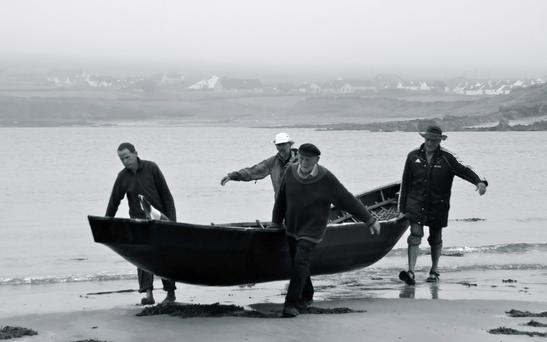 Danny Sheehy, Breandán Ó Beaglaoich, Liam Holden and Brendan Moriarty who will set off rowing a naomhog to Spain this week.