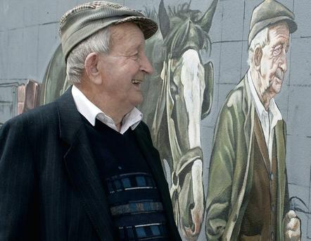 Jimmy O'Connor and the mural depicting him