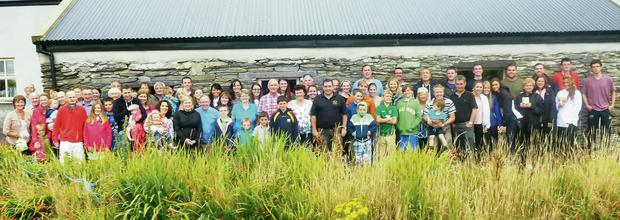 The Americans and their Valentia cousins at the old homestead of their ancestors at The Mill, Valentia Island.