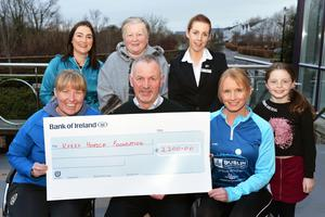 Michelle Greaney, 'MG Coaching' Blennerville, presents a cheque for €2,200 proceeds of the 10miler & 5k run last Sunday to the Chairman Kerry Hospice Foundation, Tralee Branch, Dan Galvin and Andrai O'Donoghue PRO KHF, at back fromleft Claire O'Connor, Ita Greaney, Orla Greaney and Meaghan Barrero. Photo: John Cleary.