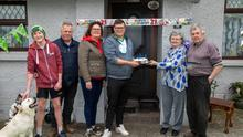 Triple celebrations at Nora and Johnny Kelly's house Lohercanon, Tralee on Sunday as Sean who celebrated his 21st birthday, Domnick (13th) and Liz and Padraig Regan, Kilmoyley South, celebrated their 22nd Wedding Anniversary. Nora, grandmother of Sean presenting him with his 21st birthday cake at her home. Photo Joe Hanley