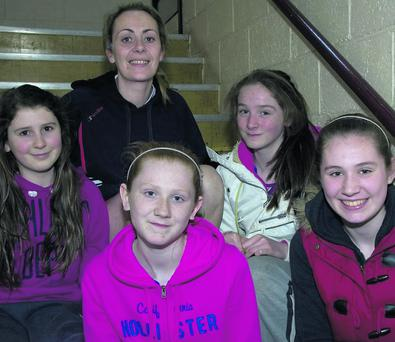 Members of the Horan's Lixnaw team and their coach, Garda Mary Gardiner from left: Saoirse O'Carroll, Orlaith Cullen, Aoife Mahony and Niamh Cullen at the Jim Lay Basketball Tournament at Listowel Community Centre on Saturday afternoon. Photo: John Reidy