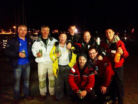 Celebrating in the early hours at Dingle Harbour the winning Amazing Grace crew are back row (left to right) Finbarr O'Connell, skipper Brian O'Sullivan, Fergus Kelliher, Pearse Boyland, Tim Kelliher, Cian O'Donnell. Front row Brendan Culloty and Michael McCormack. Photo: Frances Clifford