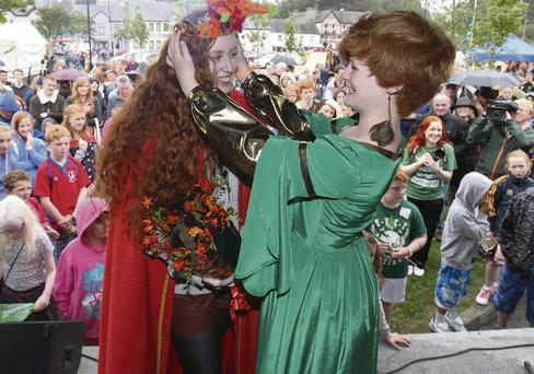 UCC student Sarah Mullins from Tralee receives her Queen Of The Redheads crown from last year's queen Máirin-Rua Hayes at the fourth Annual Red Head Convention in Crosshaven, Co Cork at the weekend. Photo by Darragh Kane