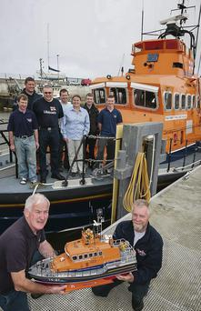 Fenit Lifeboat Operations Manager Gerard O'Donnell was presented with a working model replica of the Fenit Lifeboat by engineer Keith Baxter from Huddersfield. Pictured also are crew members John Moriarty, Adrian O'Mahony, Kevin Honeyman, Kevin Moriarty, Denise Lynch, Billy Moriarty and Aaron Williams.
