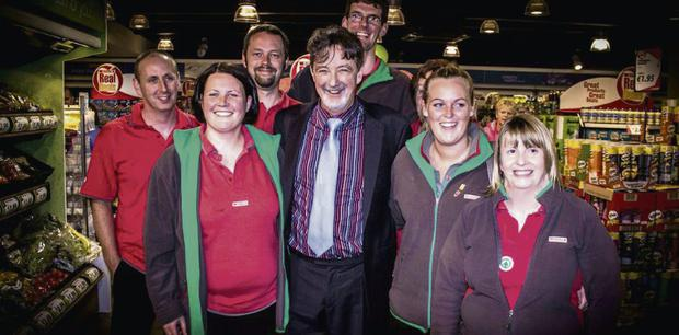 'Fair City' star Tom Hopkins at the opening of the new Spar store on Market Street in Listowel with staff members.
