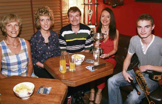 Herlihy's Bar proprietor, Marie O'Sullivan (second from right), pictured during the reception she hosted for double All-Ireland Fleadh Cheoil winning musician Micheál Ó Sé during 'Maura's Rambling House' in Farranfore. Included are Micheál's parents, Joan and Noel and sister Bríd. Photo by John Reidy