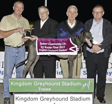 Second from left Dan O'Connor, chairman of the Tarbert Community Centre, presents the winning trophy to trainer/owner Donal G O'Mahony after Millridge Leader won the Tarbert Community Centre Buster Final at the Kingdom Greyhound Stadium on Saturday night. Also pictured are Dan O'Mahony and Fr Danny Broderick PP Tarbert.