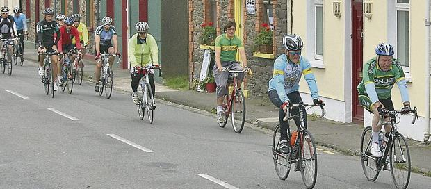 Minister Deenihan leads the cyclists back into Dingle on Sunday.