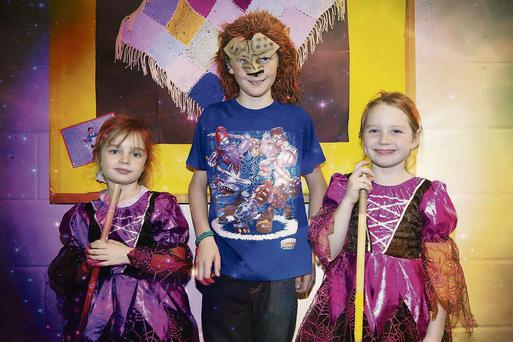 Leeann Collins, Kieran O'Donoghue, and Shannon Collins dressed for Halloween at the launch of Killocrim School's new website on Thursday last.
