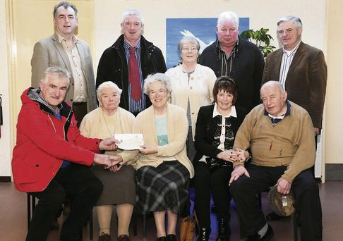 Danny Tim O'Sullivan presenting a cheque for €10,000, proceeds of the recent Charity Dance in Dollis Hill to Sr Consilii and Sr Helena of St Josph's Home, Killorglin with Sheila O'Sullivan, Johnny Mahony. Back, from left: Cllr. Michael Cahill, Sean O'Shea, Sr. Elizabeth, Patsy Horgan and Dermot Galvin at St Joseph's Home, Killorglin.