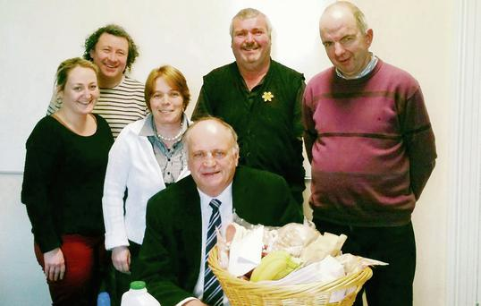 Listowel traders make a presentation to Den Stack, third from right