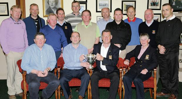 Mike Daly Captain (seated third from left) presenting the Arbutus Cup to winner Colm O'Connor with (left) Tadg O'Connor, Mary Geaney Club President (back from left) winners of the club foursomes Paudie Sheahan, Conor McNeice, Tim O'Keeffe, Dan Joe Cahill, Tom Long, Fergus Houlihan, John O'Shea, David O'Callaghan, Teddy Bowler, Tom Murphy and Ronan Kelliher at Killarney Golf Club on Monday. Photo by Michelle Cooper Galvin