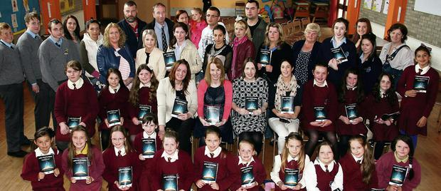 A gathering at the launch of the Write A Book project at Scoil Muire gan Smál Primary School on Monday morning. Included are: Deirdre Fitzgerald, Kerry Education and Training Board; Maura Browne, deputy principal; Leona Twiss, principal and Maggie Prendiville, Kerry Education and Training Board course tutor.
