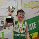 St. Brendan's U12 captain Donal O'Sullivan holds aloft the KABB Cup