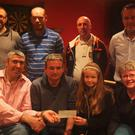 A cheque for €6900 being presented to the Brosna Gaa Lotto Jackpot winner Aenie Leahy and his daughter Chloe. Back Row from L-R: Seamus McAuliffe, Micheal Murphy, Mike Brosnan, Paul Curtin. Front Row from L-R: Mikey Joe Walsh, Aenie Leahy, Chloe, Kay Walsh