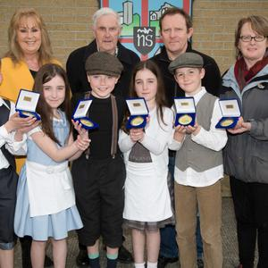 Launching the special centenary medal at Ardfert NS were pupils Megan O'Connor, Rachel O'Connor, Shane O'Connor, Patrick Stack, Ainle Foley, Betty Stack (principal), Helen O'Carroll (Kerry Museum), Donal Stack (designer) and Sean Seosamh Ó Chonchubhair.