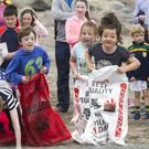Competing in the sack race at the Ventry Regatta. Pic: Declan Malone