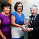 At a function in his honour at the Imperial Hotel, Tralee, on Saturday night. Tony O'Brien, Firies (Inspector with Bus Eireann) retires from Bus Eireann after 30 years in the South Kerry area. L to R: Liz O'Sullivan, Bus Eireann, Mariam Flynn, Regional Manager Bus Eireann South/West area who presented Tony O'Brien with a Crystal Lamp to mark the occasion, Stephanie Ryan, Regional School Transport Manager Bus Eireann. Photo: John Cleary