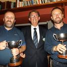 Michael Mercer, Captain of Castlegregory Golf Club, presenting the John Brown Memorial Scratch Cups to the overall winners, Colin O'Sullivan (left) intermediate and Richie Greer (right) junior