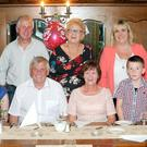 A 60th birthday celebration was held for Mary Dowling, Duagh in Leens Hotel, Abbeyfeale, pictured with her husband Michael, daughter Helena and son Moss and other family members. Photo: Kevin Flynn